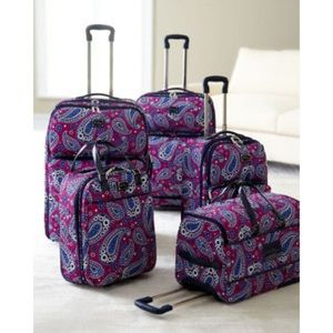 ISO.... Vera Bradley carry on with wheels.